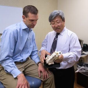 doctor diagnosing chronic back pain